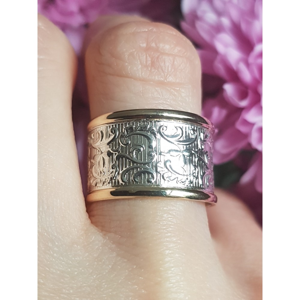Sterling silver and gold wedding band