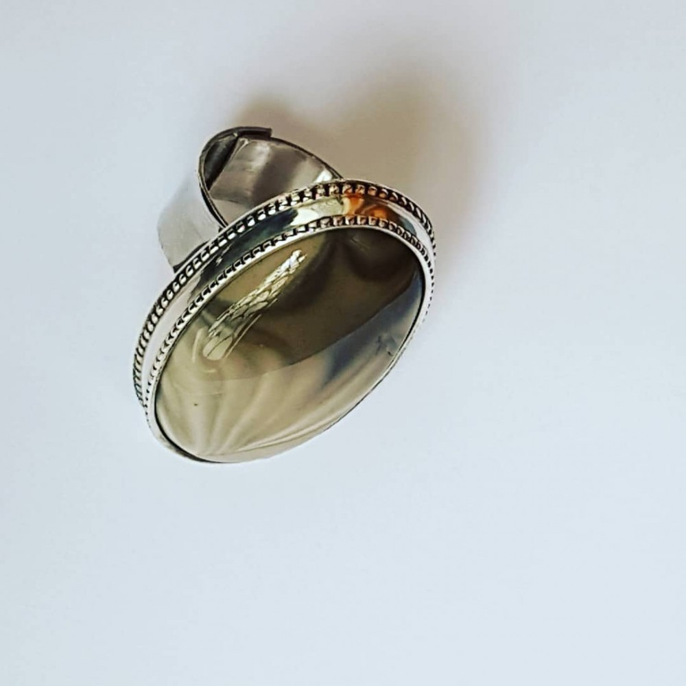 Sterling silver ring with natural creme color