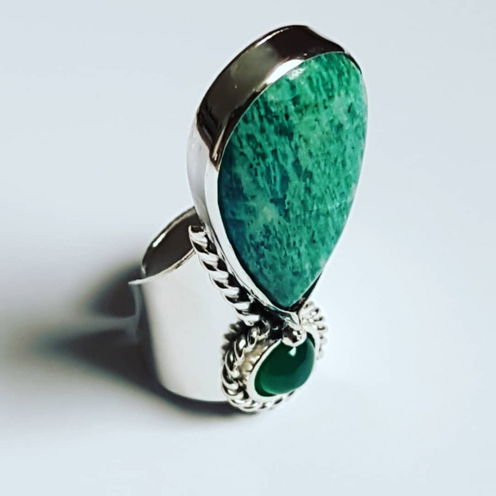 Handcrafted Sterling silver ring with Natural and agitated green amazon Hanging on green