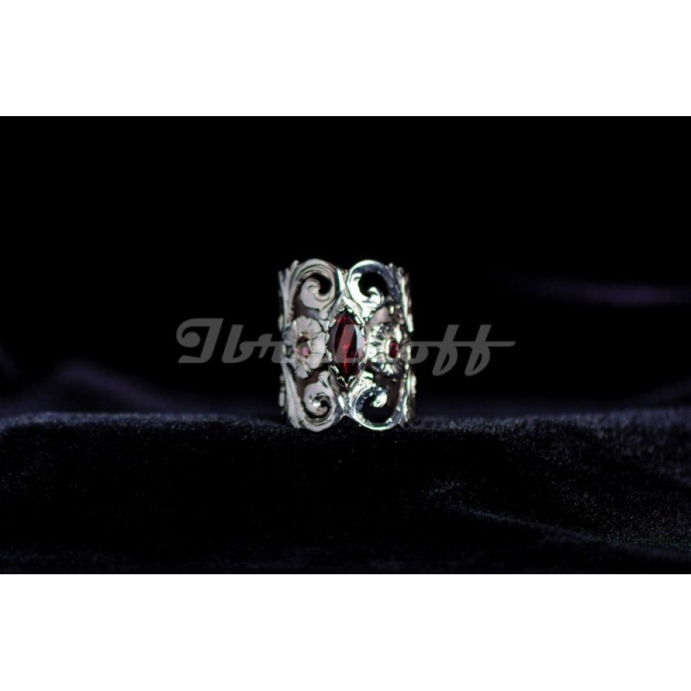Silver sterling ring with red central granate and pink side granates