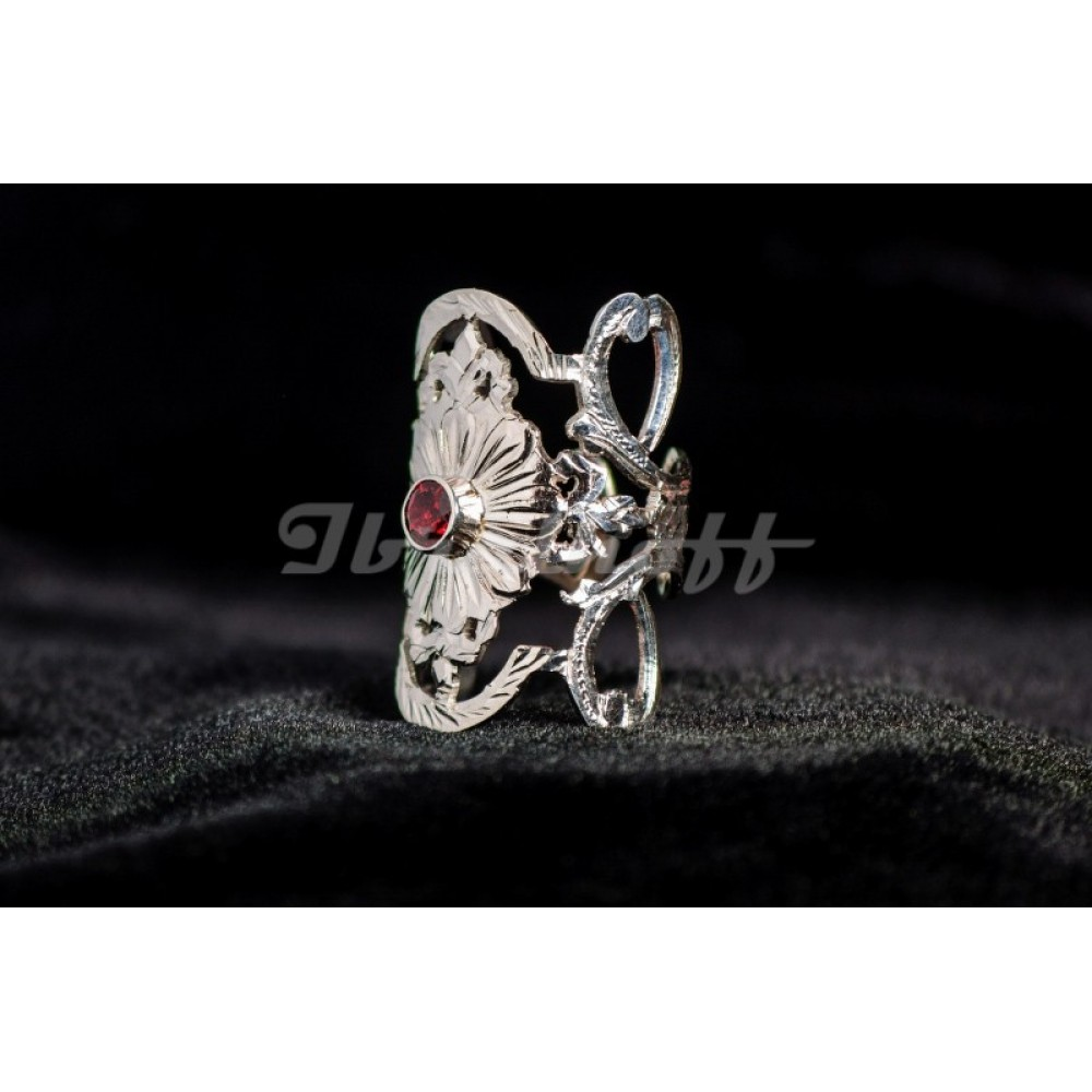 Silver sterling ring with red granate