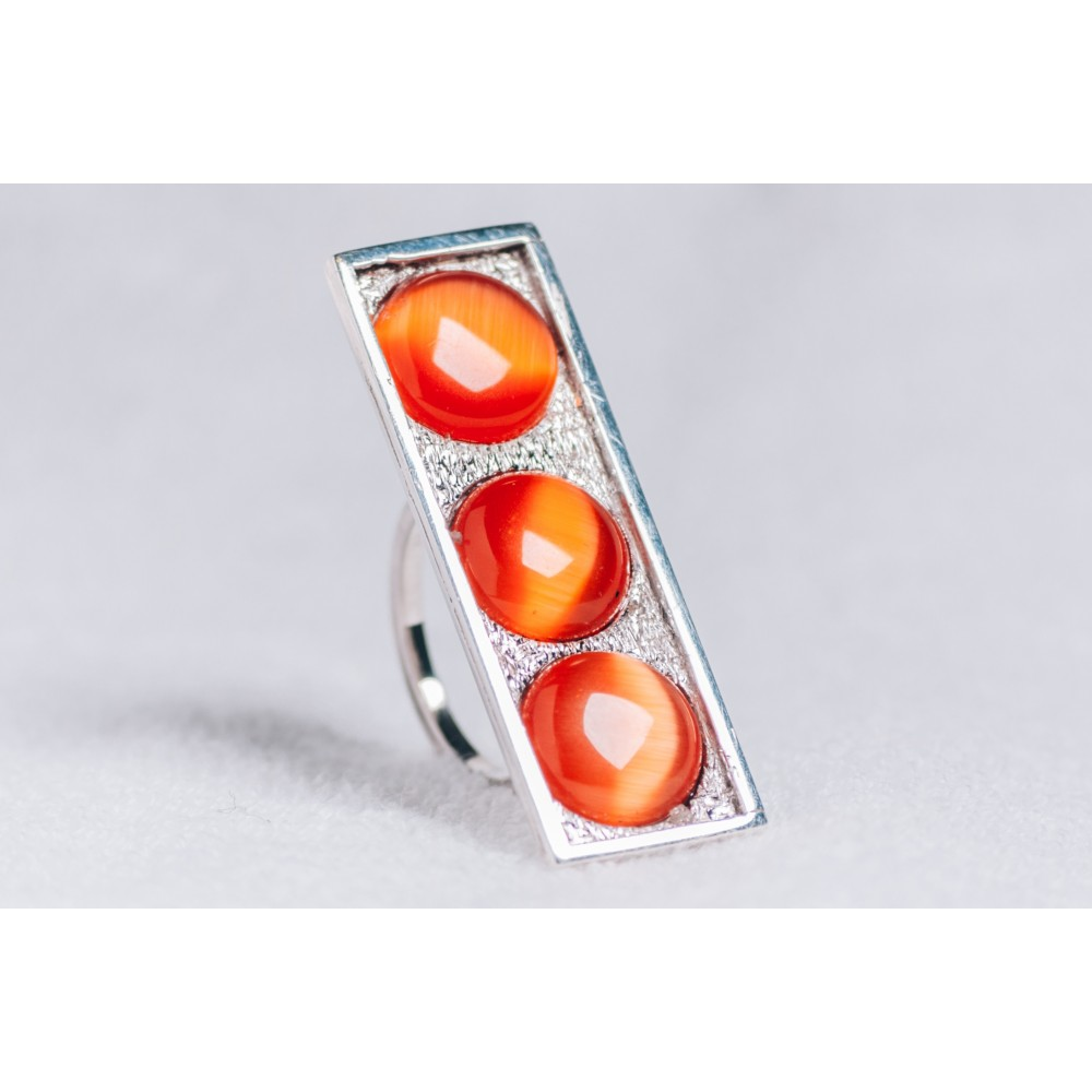 Large sterling silver ring with three orange cat's eye stones