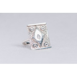 Large sterling silver ring with central diamond shape