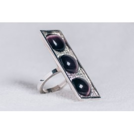 Large sterling silver ring with three deep purple cat's eye stones